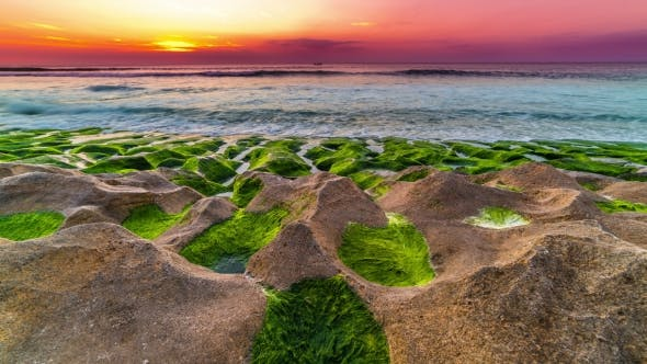 Cover Image for of Sunset on the Balangan Beach with Frozen Volcanic Funnels Covered with Algae on the Island of