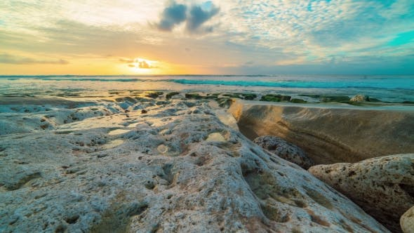 Cover Image for Beautiful Sea  of the Coast Rocks Beach Sunset on Bali in Indonesia.