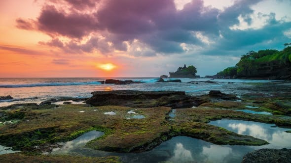 Cover Image for Sunset  at the Broken Beach. In the Distance One Can See the Temple of Tanah Lot on the Island o
