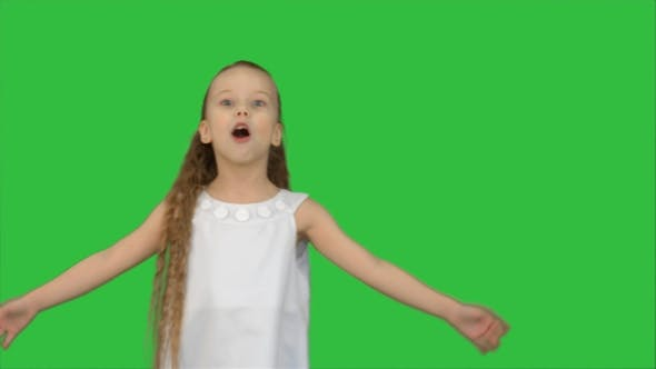 Thumbnail for Cute Little Girl Singing a Song and Dancing on a Green Screen