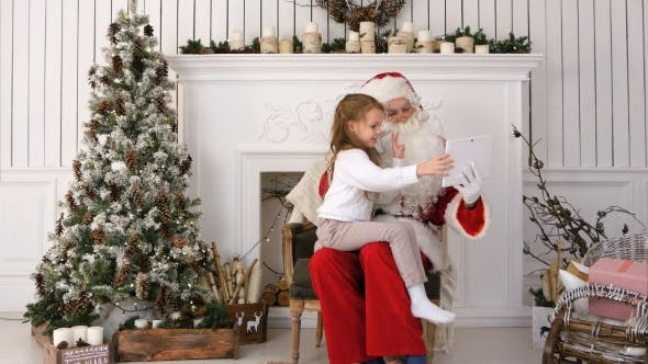 Thumbnail for Santa Claus and Cute Little Girl Taking Christmas Selfies on Tablet