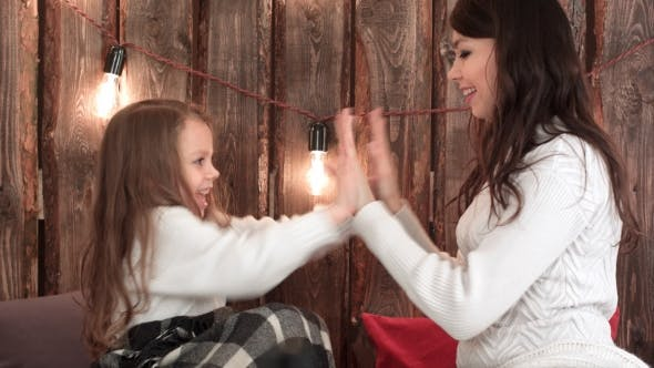 Thumbnail for Happy Mother and Daughter Playing Clapping Game on Christmas Eve