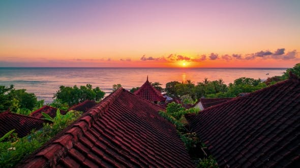 Thumbnail for View Sunrise the Background of the Ocean and Roof Bungalows with Tropical Trees in Amed on the