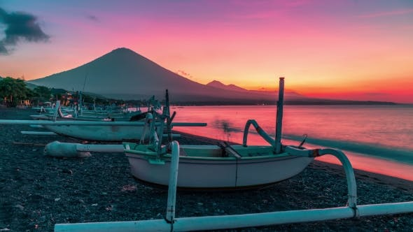 Thumbnail for Sunset Overlooking the Agung Volcano  on the Background of Fishing Boats on the Beach of Djemeliuk i