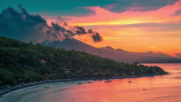 Thumbnail for Epic Sunset  in the Jemeluk Bay with a View of the Ocean and Clouds Above the Volcano Agung in Bal