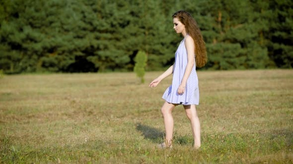 Thumbnail for Incredible Beautiful Woman Wondering Around in Field Alone Enjoying the Last Summer Days
