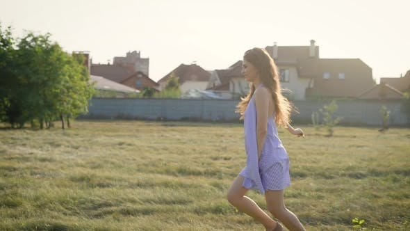 Thumbnail for Very Happy Young Beautiful Woman Running Alone Across the Field Wearing Dress and Enjoying Her Life