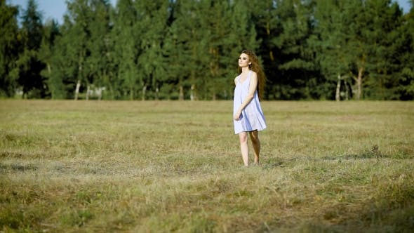Thumbnail for Incredible Beautiful Woman Wondering Around in Field Alone Enjoying the Last Summer Day