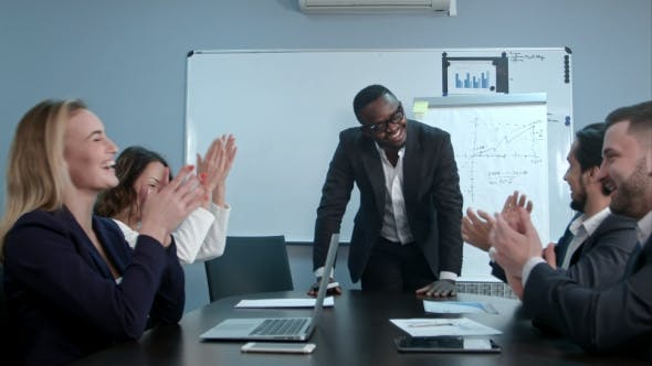 Thumbnail for Multi Ethnic Business Group Greets Afro-american Boss with Clapping and Smiling
