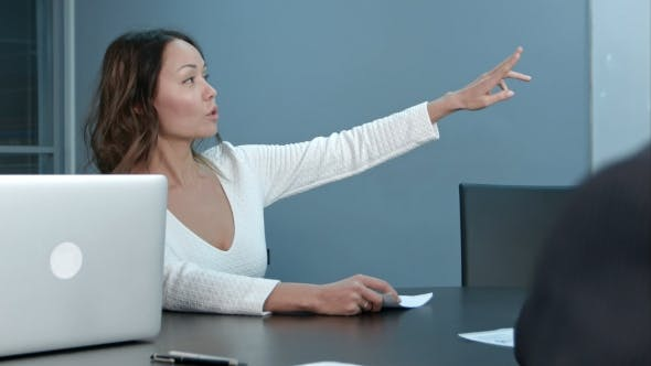 Thumbnail for Young Businesswoman Sitting on Business Meeting with Colleagues in Office, Asking Questions