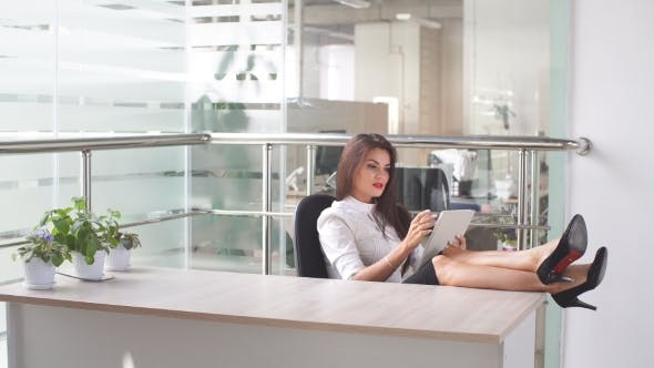Thumbnail for Attractive Woman Working on a Tablet in a Home Office