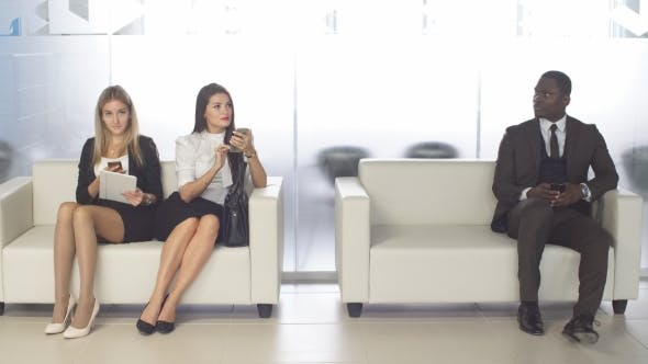 Thumbnail for Businesspeople Chatting and Waiting for Interview