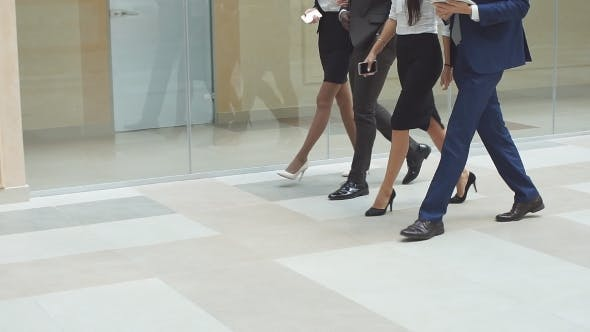 Thumbnail for Businessspeople Group Walking at Modern Helle Office Interior