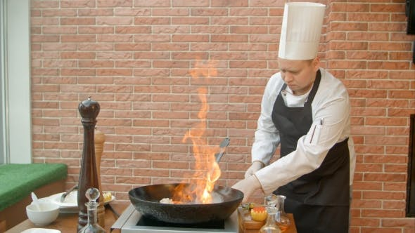 Thumbnail for Chef Preparing Seafood in Pan with Alcohol in Big Flame