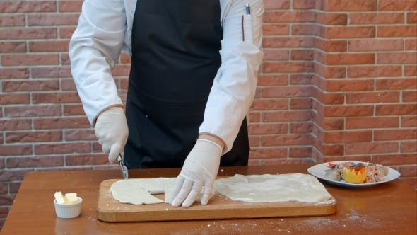 Thumbnail for Chef Hads Slicing Dough Sheet with Roller Knife