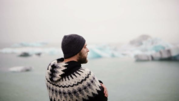 Thumbnail for Young Bearded Man Standing in Jokulsalon Ice Lagoon and Looking on Glaciers, North Nature in Iceland
