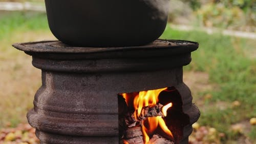 Cooking Outdoors in Cast-iron Cauldron