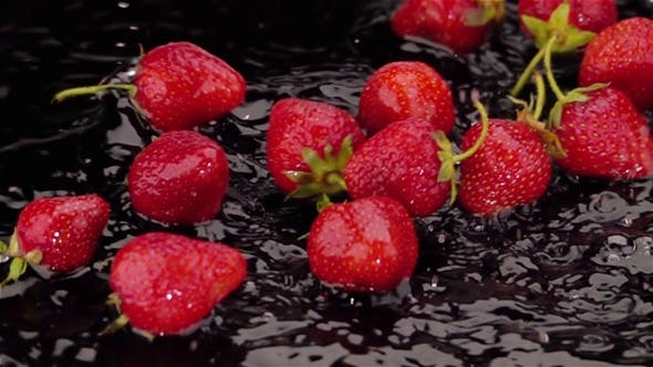 Thumbnail for Ripe Strawberries Falls on the Table.