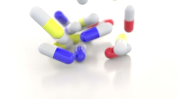 Cover Image for Falling Colorful Drug Capsules or Pills