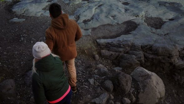 Thumbnail for Young Traveling Couple Walking Through the Mountains, Going To See Glaciers in Vatnajokull Ice