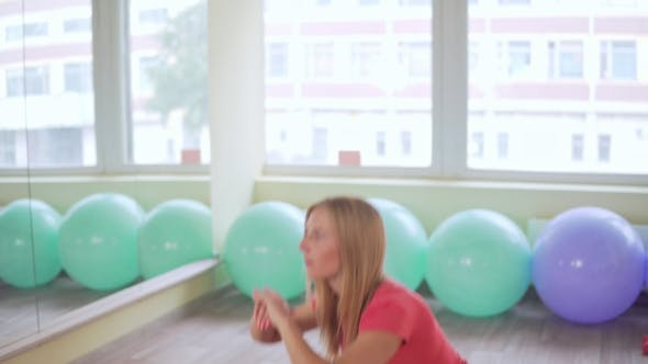 Thumbnail for Young Attractive Woman Doing Sit-ups in the Gym. Fitness