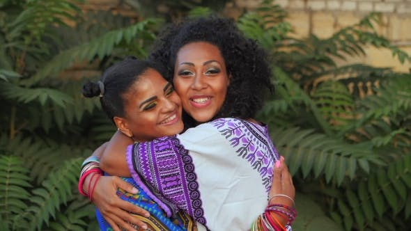 Thumbnail for Two Happy Beautiful Afro-american Women Friends Hugging Outdoor in Park. Multi Ethnic Girls Wearing