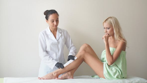 Thumbnail for Women Legs and Hair Removal with Hot Wax Painful Procedure. Woman In A Beauty Salon Doing Depilation
