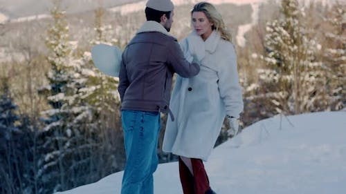 Couple on the Background of Mountains
