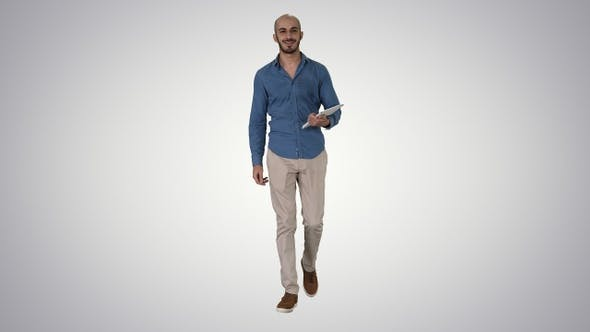Cover Image for Arab presenter walking with digital tablet swiping pages