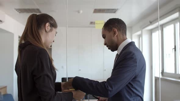 Thumbnail for Mentor Explaining Young Employee How To Work with Memos