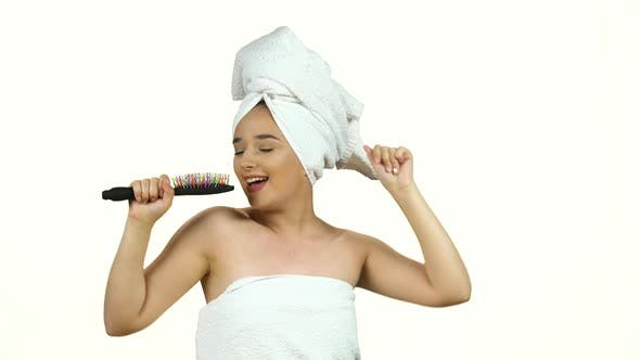 Thumbnail for Woman in White Towel on Her Head Dance and Sing Into Comb As in Microphone Isolated on White