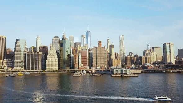 Thumbnail for Aerial View of Famous City, New York, America. Drone Flying Over the East River with Boat Riding