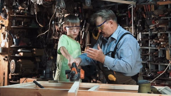 Thumbnail for Man with Boy Making Window