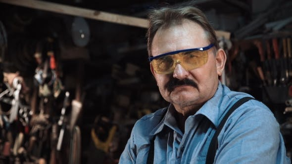 Portrait of an Adult Carpenter in the Shop