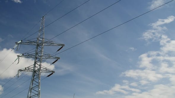 Cover Image for Power Transmission Line With Cloudy Sky On The Background