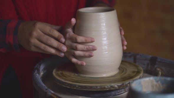 Thumbnail for Pottery Couple Hands Making Clay Jug