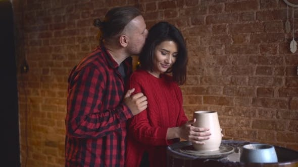 Thumbnail for Sweet Pottery Couple Making Clay Jug on Potter's Wheel