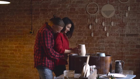 Thumbnail for Pottery Couple Making Clay Jug