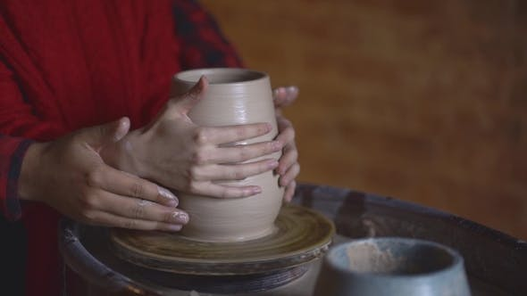 Thumbnail for Couple Making Clay Jug on Potter's Wheel
