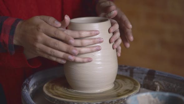 Thumbnail for Couple Hands Making Clay Jug on Potter's Wheel