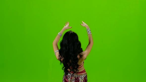 Thumbnail for Woman Standing Back in Costume with Ornaments Dancing Belly Dance. Green Screen. Slow Motion