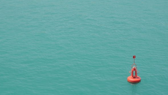 Thumbnail for Red Buoy Floating in Sea Water