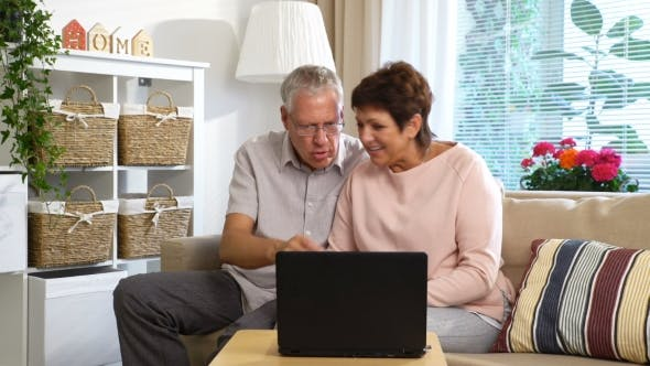 Thumbnail for An Elderly Couple Communicates with Laptop Video Call