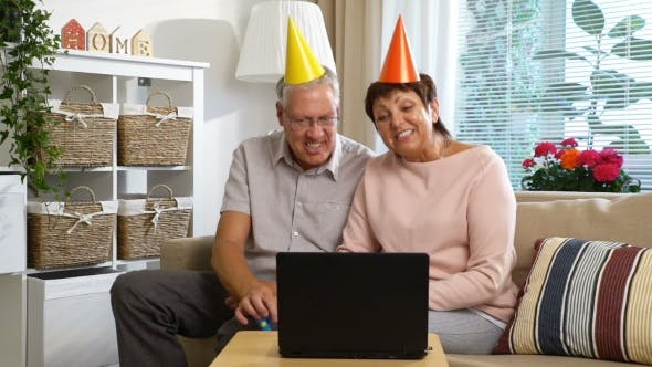 Thumbnail for Happy Grandpa and Grandma Congratulate Their Children Happy Birthday Using Laptop Video Call