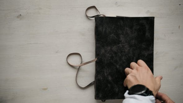 Cover Image for Mans Hands Open Handmade A4 Notebook with Real Leather Cover