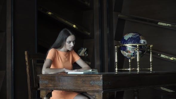 Thumbnail for Beautiful Girl Reading a Book in the Library