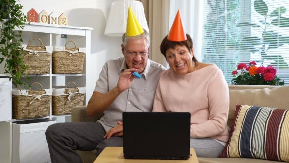 Thumbnail for Happy Grandpa and Grandma Congratulate Their Children Happy Birthday Using Laptop Video Call