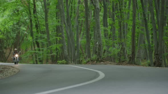 Thumbnail for Riding a motorcycle through forest