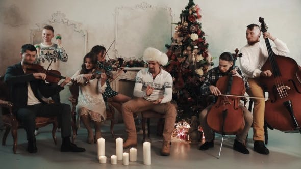 Thumbnail for String Quintet with Man Joyfully Clap Hands in Room with Christmas Decorations