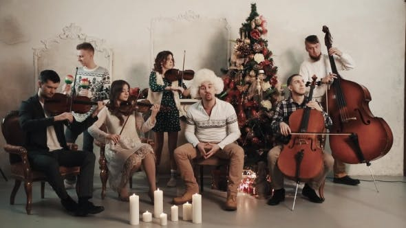 Thumbnail for String Quintet with Singer Playing Music in Room with Christmas Scenery